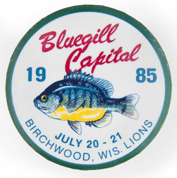 """BLUEGILL CAPITAL 1985 / BIRCHWOOD, WIS. LIONS"" ANNUAL LOCAL EVENT BUTTON."