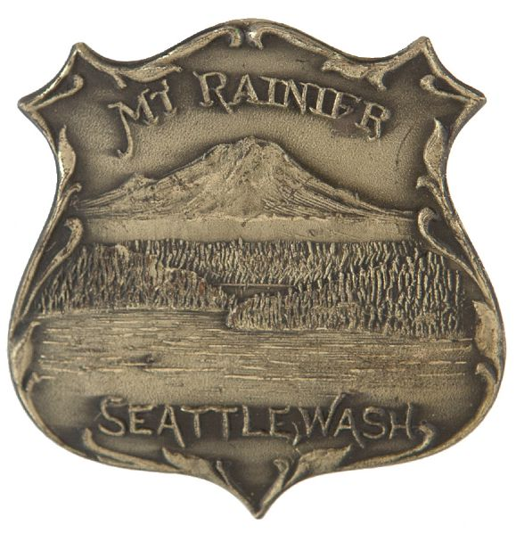 """MT. RAINIER / SEATTLE, WASH"" CIRCA 1909 ALASKA – YUKON – PACIFIC EXPOSITION METAL BADGE."