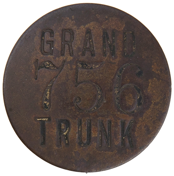 """GRAND TRUNK"" NUMBERED BRASS EMPLOYEE RAILROAD BADGE."