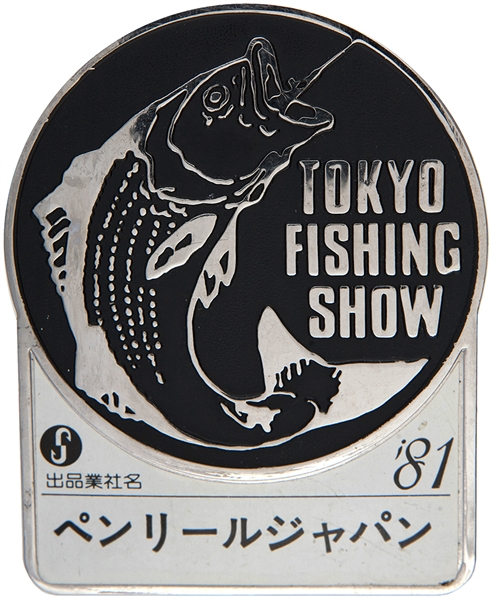 """TOKYO FISHING SHOW"" LARGE CLIP ON 1981 METAL BADGE."