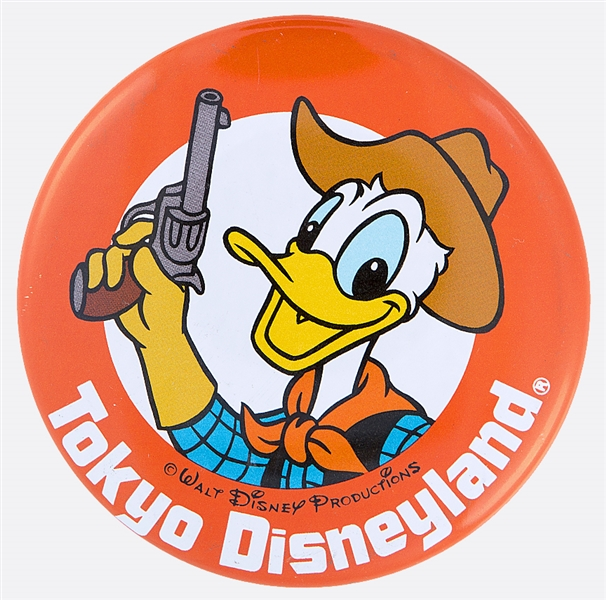 TOKYO DISNEYLAND WITH DONALD DUCK OFFICIAL DISNEY LITHO BUTTON.