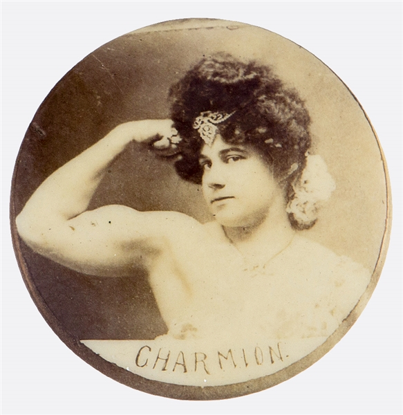 CHARMION AMERICAN TRAPEZE ARTIST AND STRONGWOMAN FLEXING ARM REAL PHOTO BUTTON.